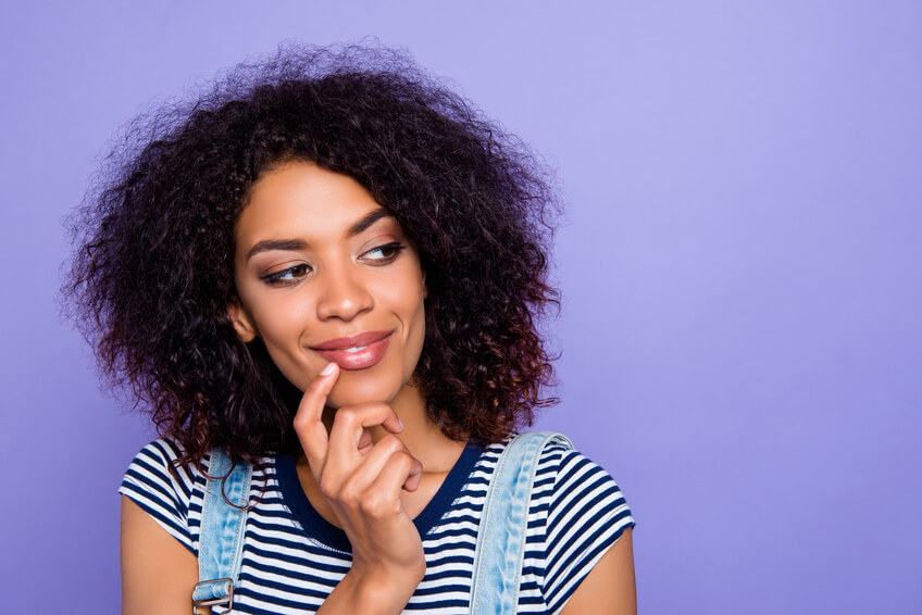 A woman thinking about dating sites by ethnicity