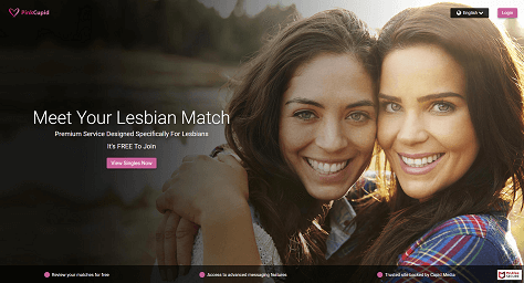 landing page of pinkcupid. a cute lesbian couple smiling into the camera.
