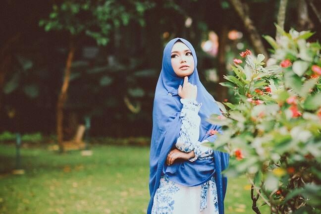 attractive muslima single standing in a garden
