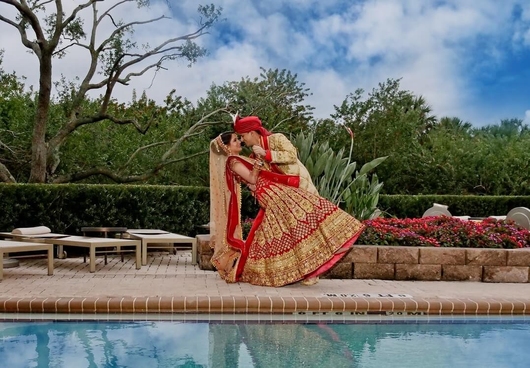 Indian couple posing for a photo after the wedding