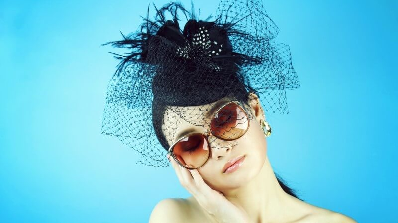 attractive widow with sunglasses and black hat waiting for a new love