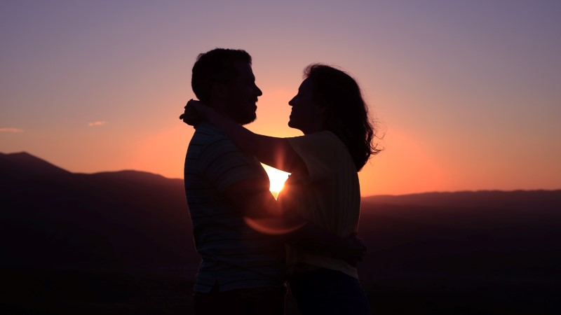 couple over 40 experiencing their happy end in the sunset