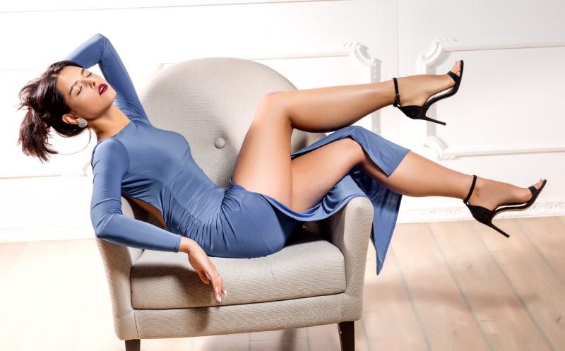 elegant cougar posing in dress