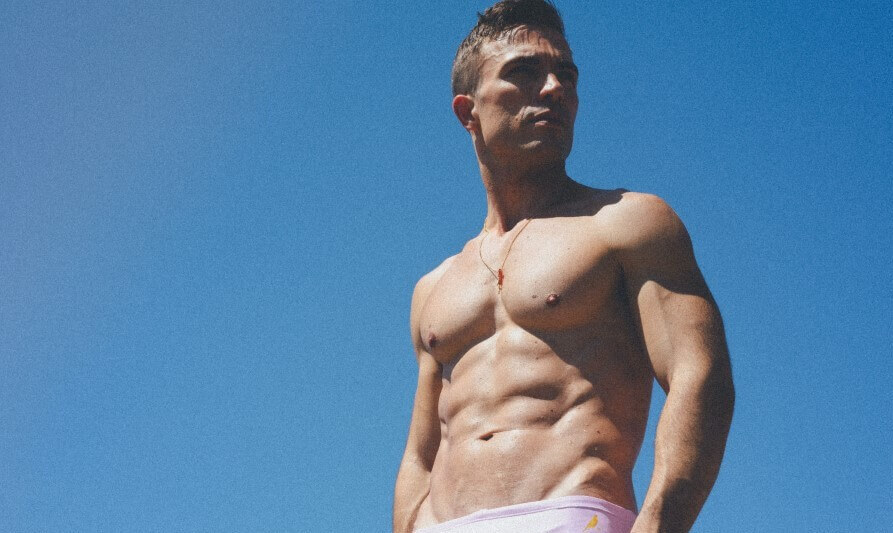 Hot man standing topless in the sun
