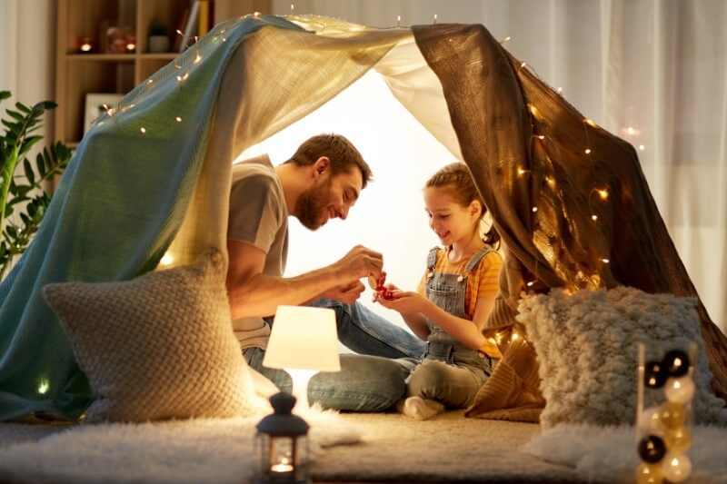 single dad has tea party with his daughter in self-built tent