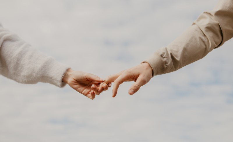 two people taking each other's hand