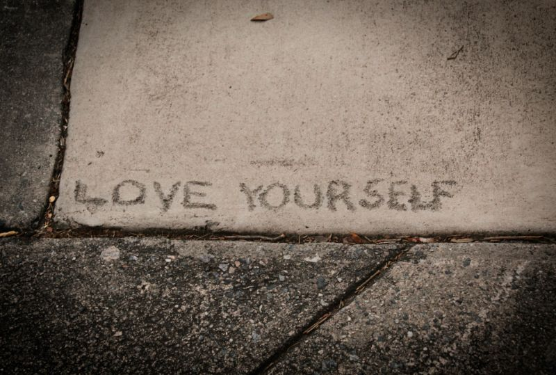 Love yourself put into a sidewalk