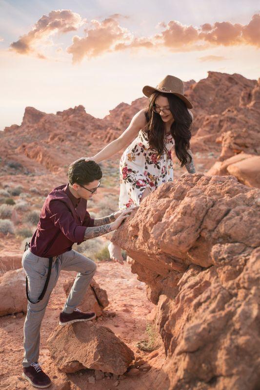 woman and man climbing rocks together