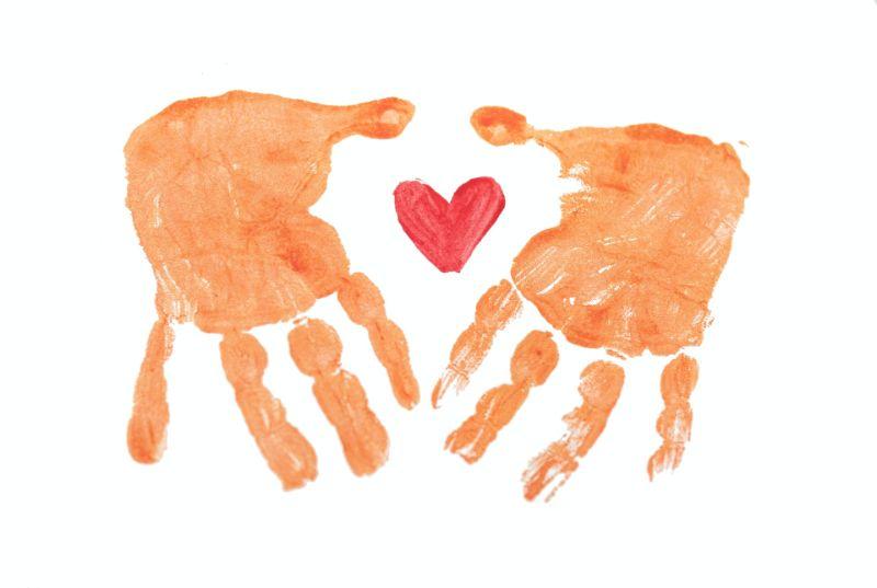 Fingerpaint hands around a heart