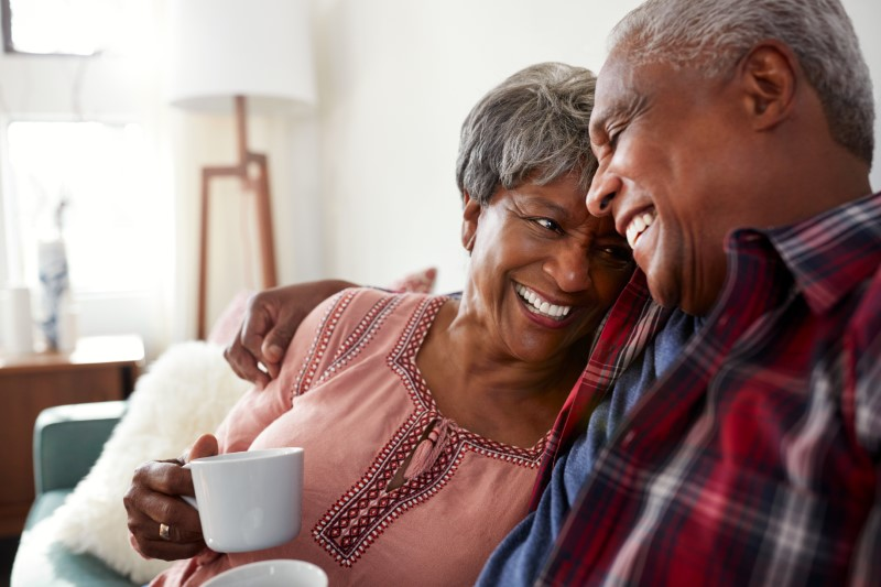 senior couple laughing together at home