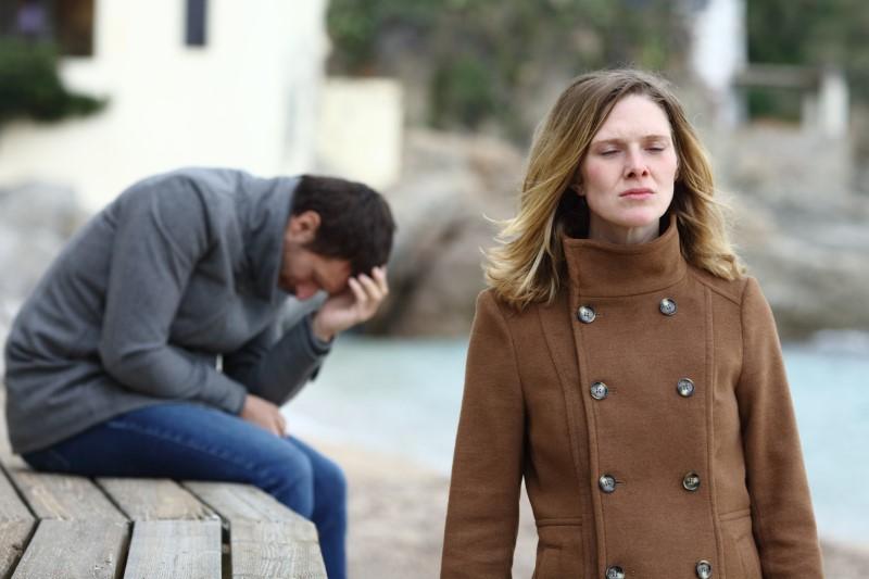 sad woman leaving man behind