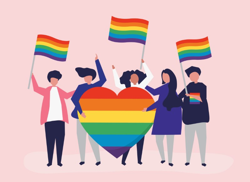 illustrated group of people with pride flags and heart