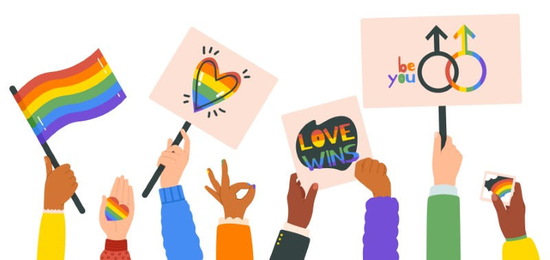 vector art of hands holding up LGBTQ pride signs